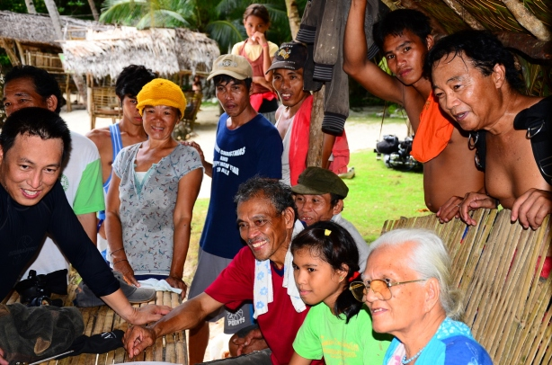 Smiling locals, happy to see what's the hidden beauty of their island.